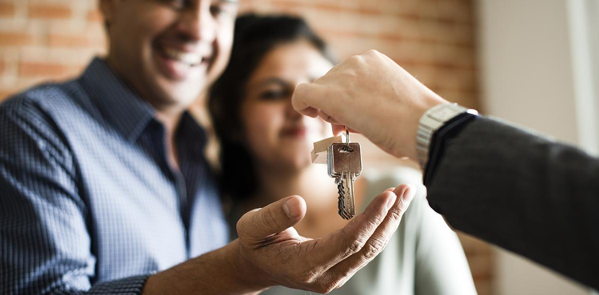 Couple receiving keys to their new home